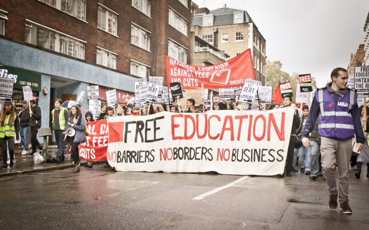 student protest with a large free education banner