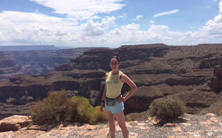 Girl posing in front of the Grand Canyon