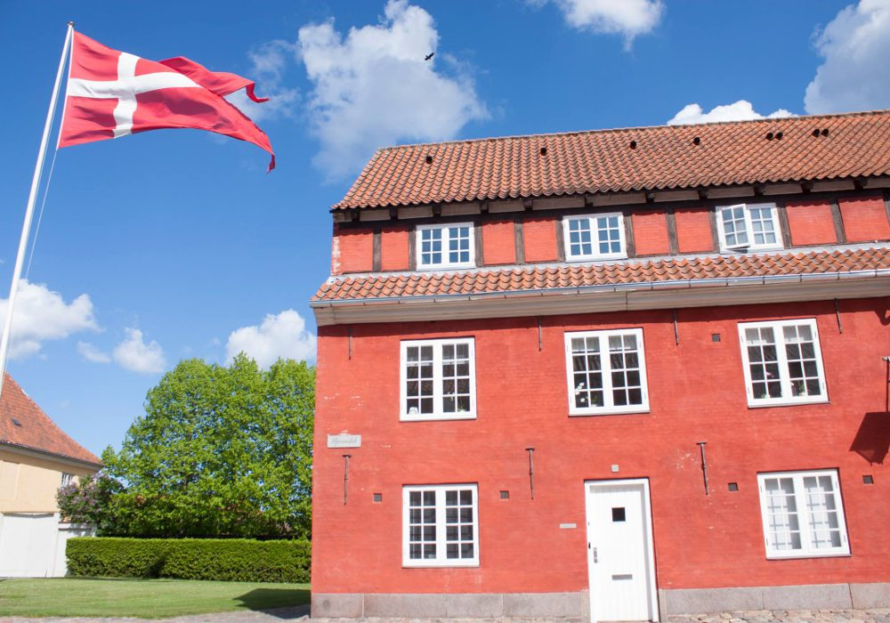 A house in Copenhagen, with Danish flag flying outside
