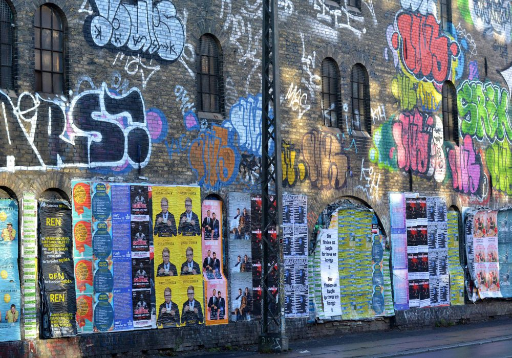 A graffiti covered wall in Christiania