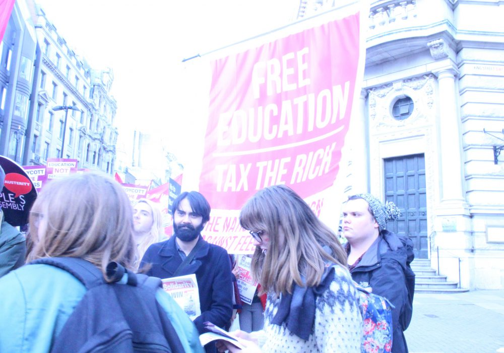 Free education tax the rich poster at student protest on november 19