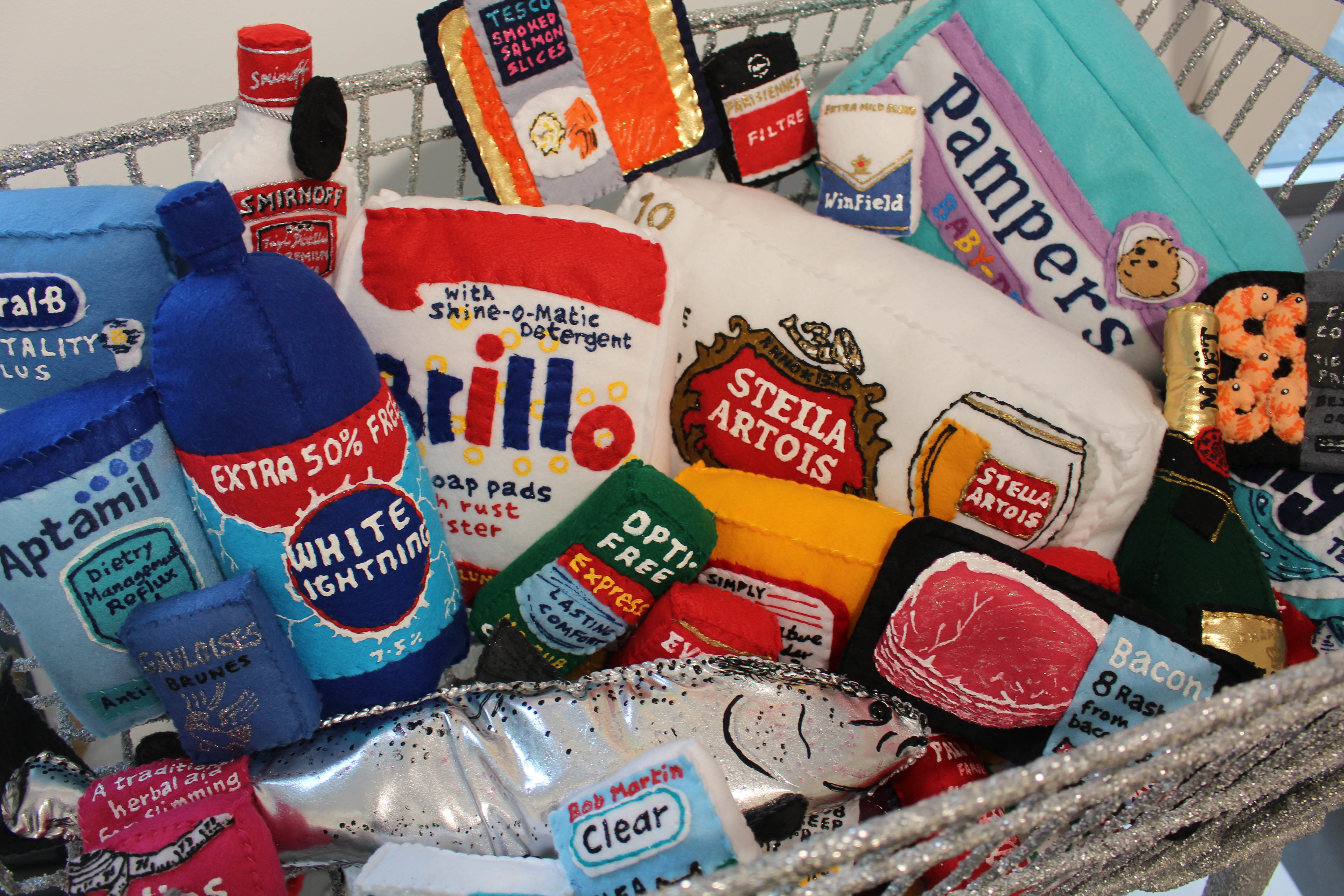 An image from Lucy Sparrow's shoplifting exhibition in at the Lawrence Atkin Gallery including felt made bacon and beer
