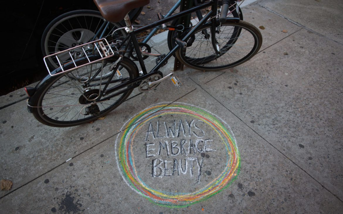 always embrace beauty, chalk street art piece in the street of new york