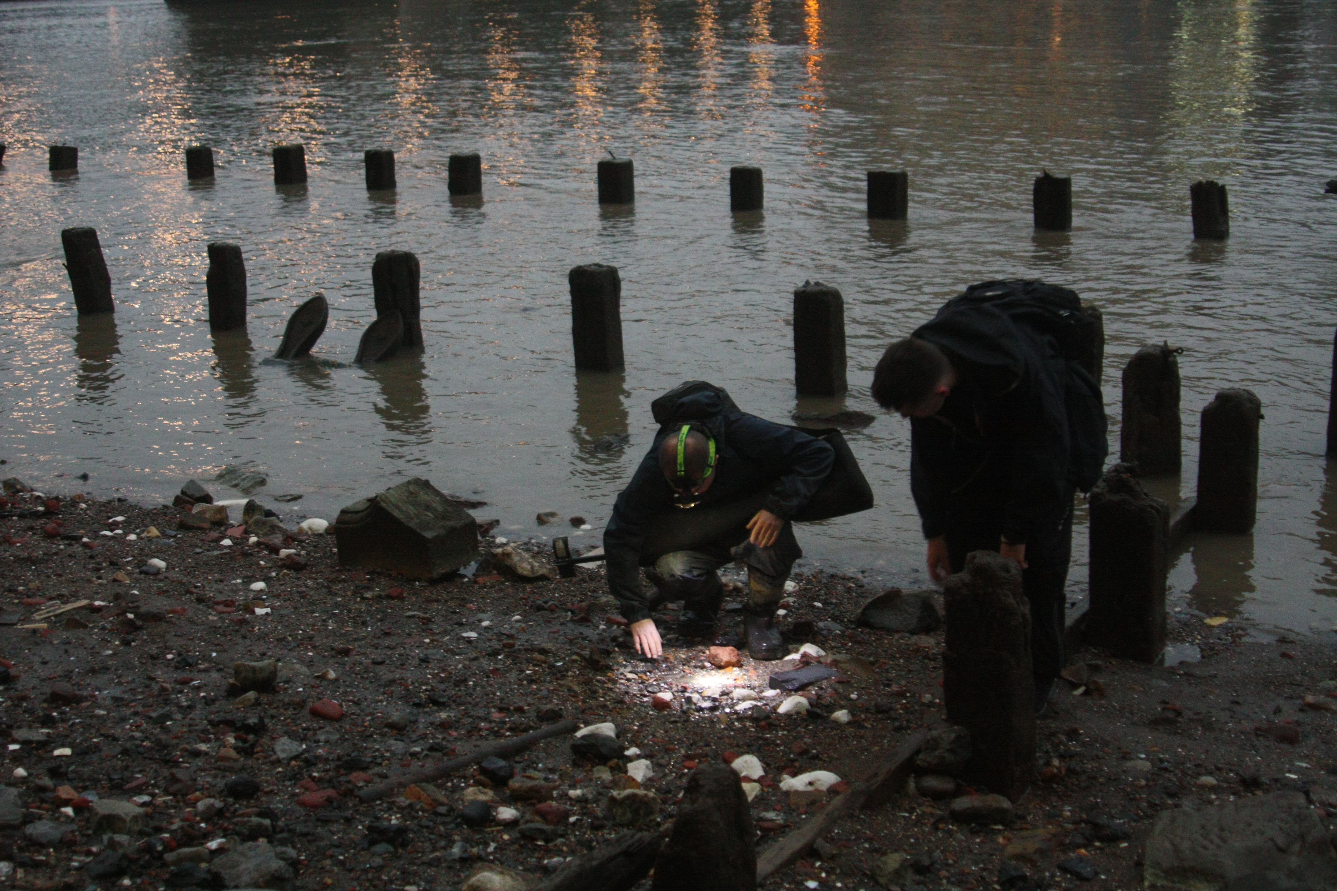 two mudlarks scouring the Thames foreshore
