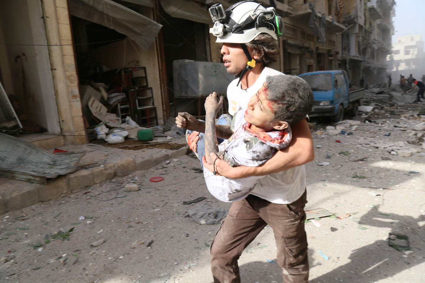 The volunteers rescue civilians when houses collapse as a result of bombardment.