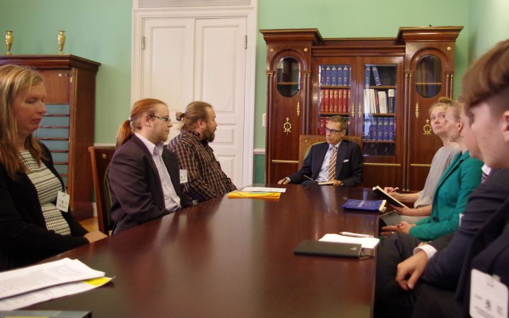Amnesty activists with Finland's 2014 PM Alexander Stubb.