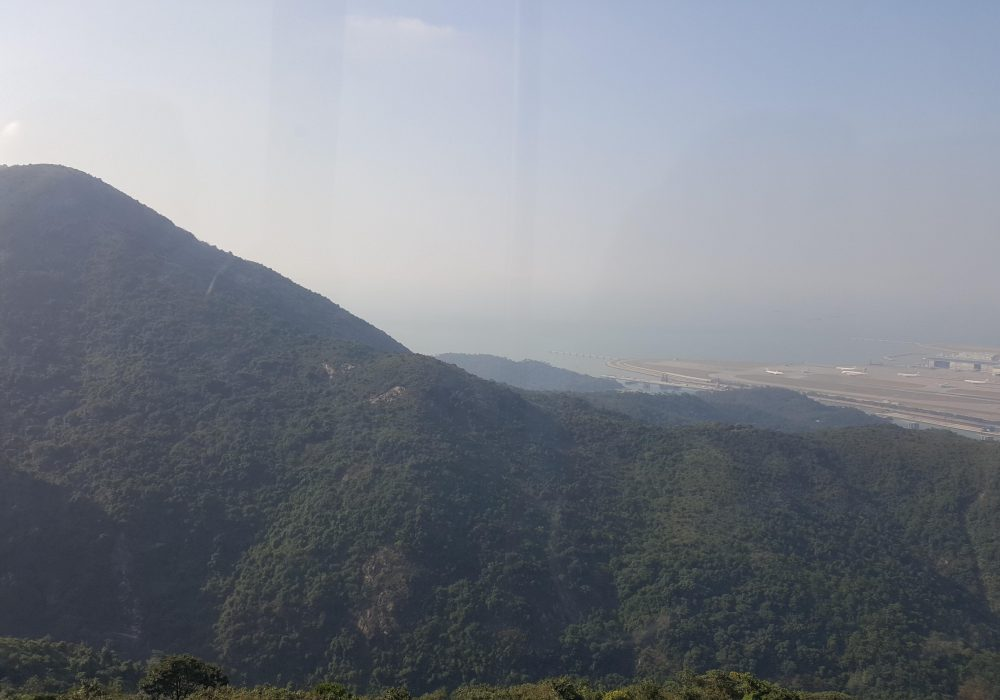 Mountain view from the Ngong Ping 360 as Hong Kong Airport can be spotted in the distance