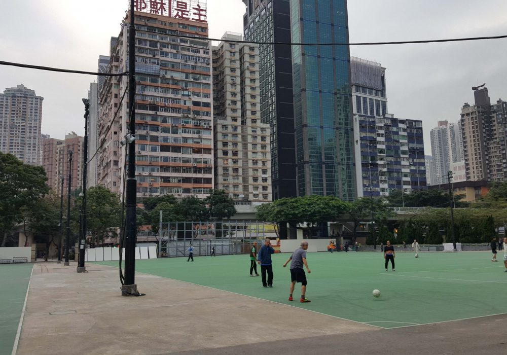 Image of Victoria Park basketball court surrounded by Skyscrappers