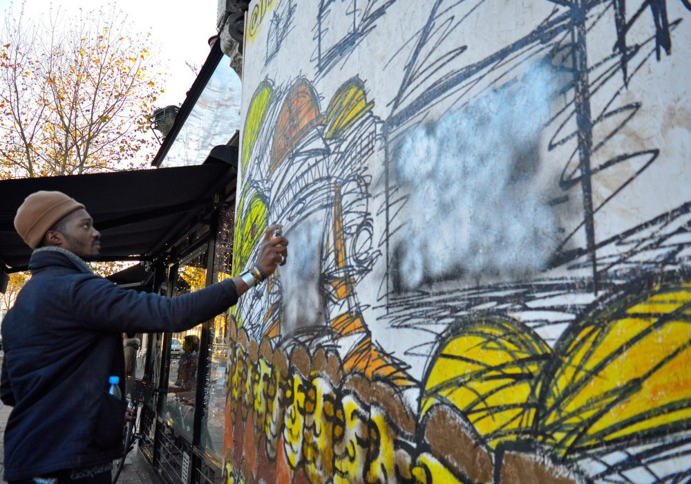 deanio_x repainting the mural