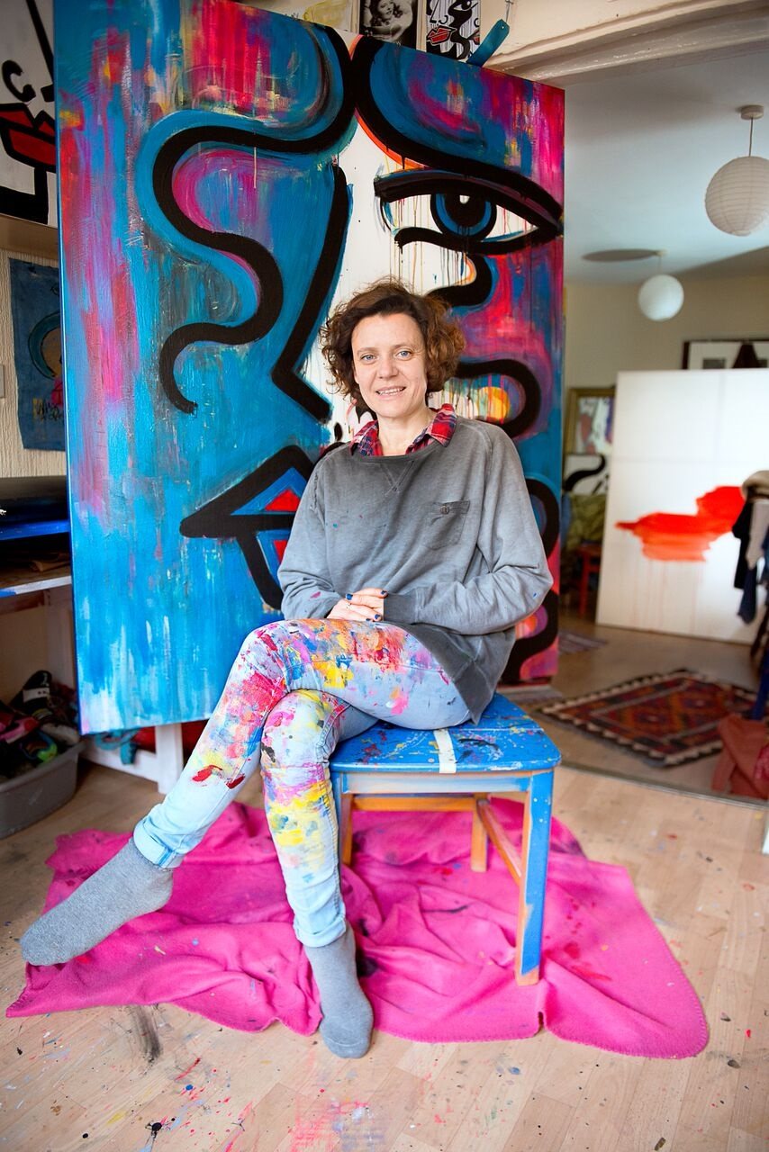 Artist with her painting