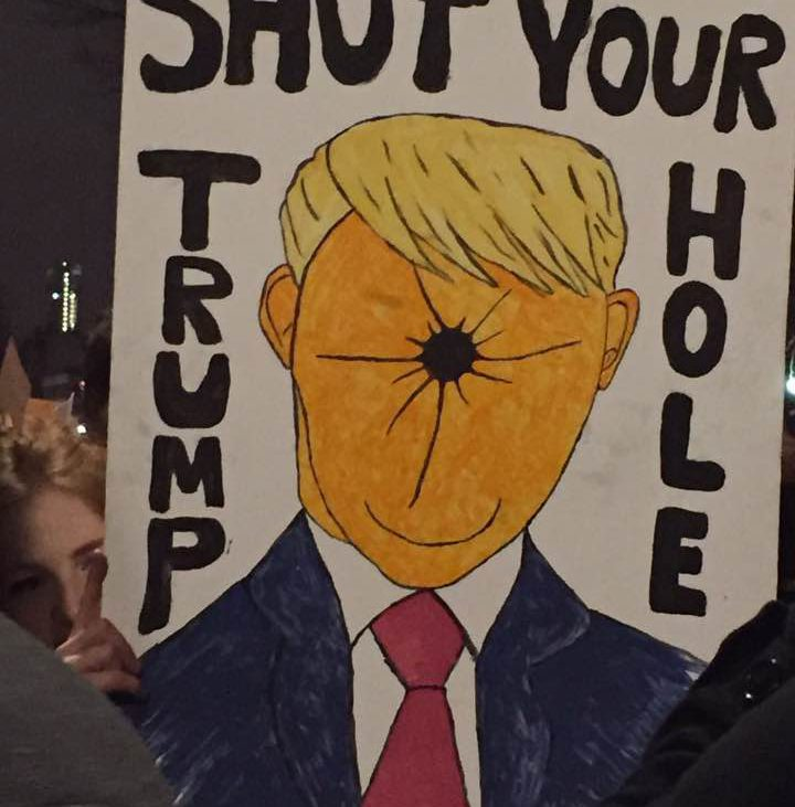 """Sign reading """"shut your Trump hole""""."""