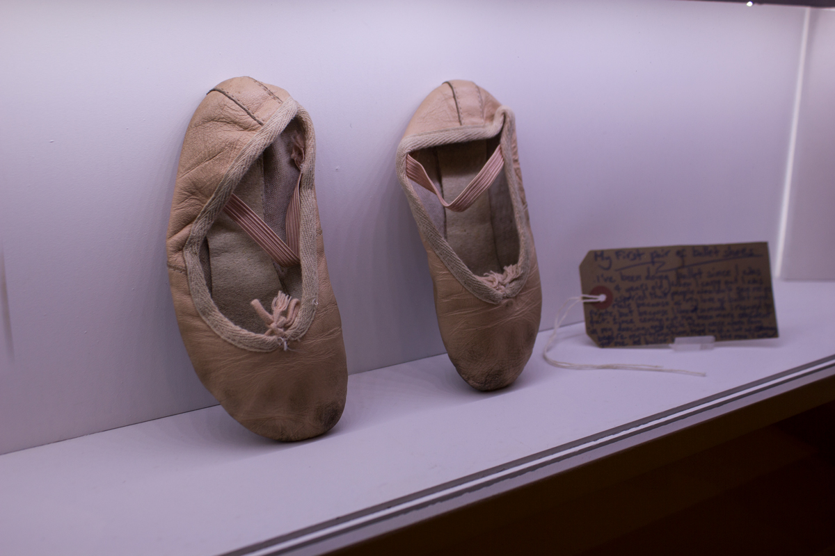 a trans man's first ballet shoes photographed at museum of transology by julius jokikokko