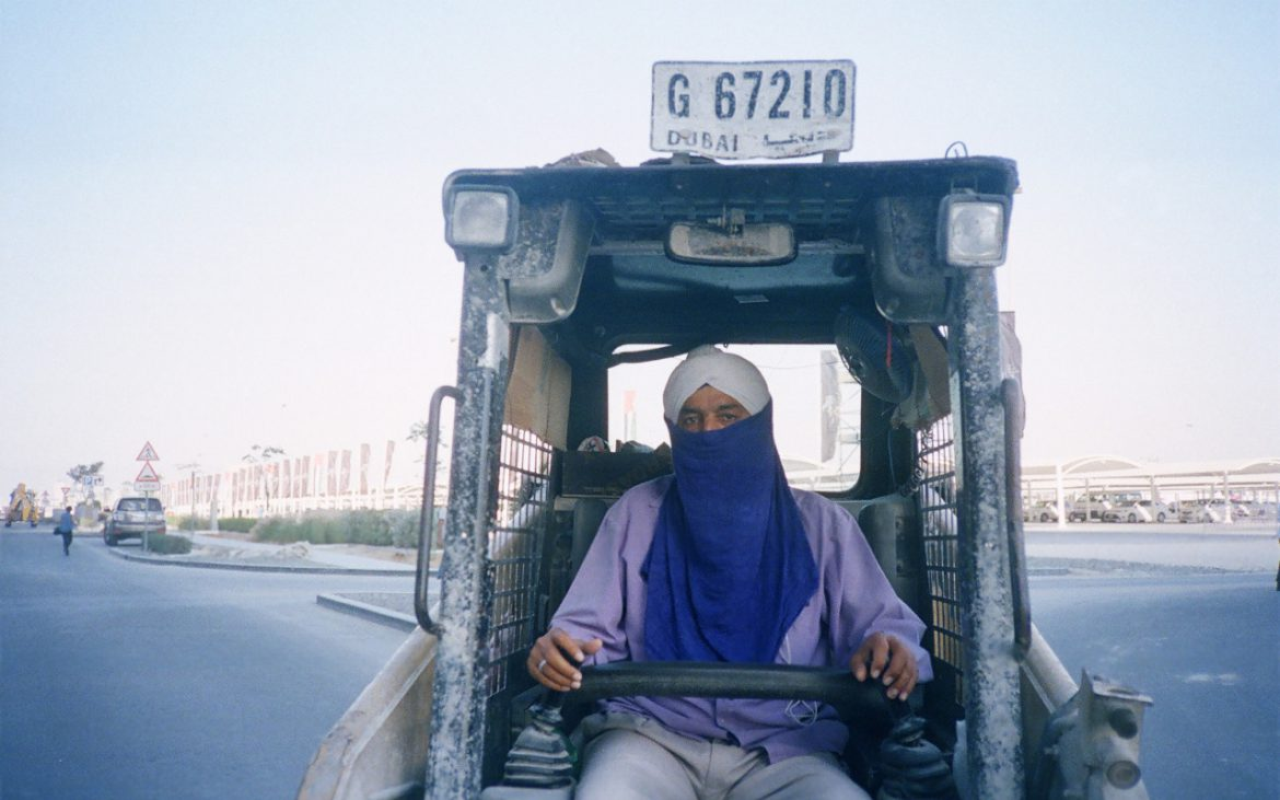 A labour worker on a machine in Dubai