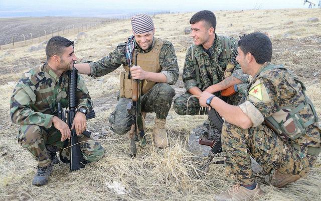 American volunteer Jordan Matson with fellow YPG fighters.