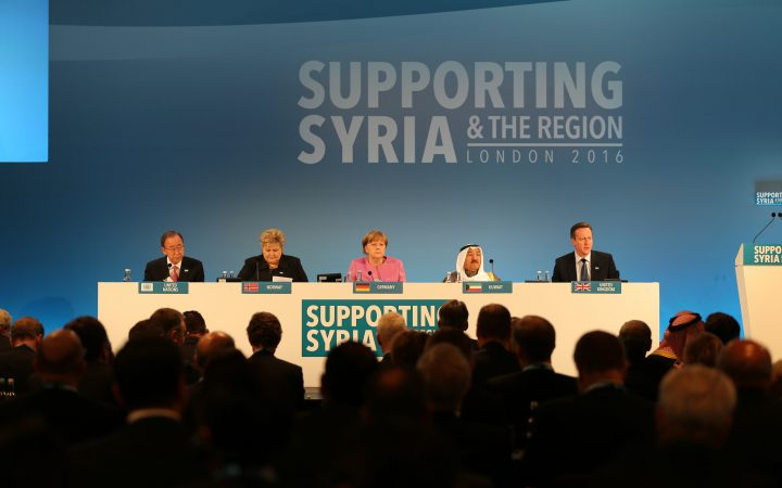 Panel including David Cameron and Angela Merkel