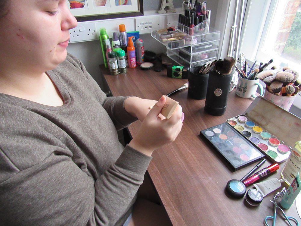 Girl is doing her makeup