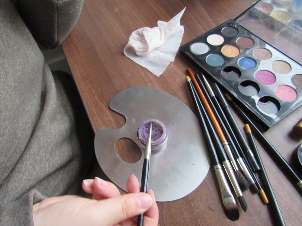 Makeup utensils lined up for use