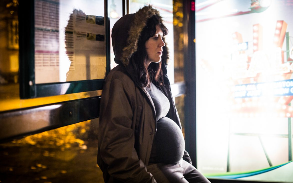 Alice Lowe at a bus stop