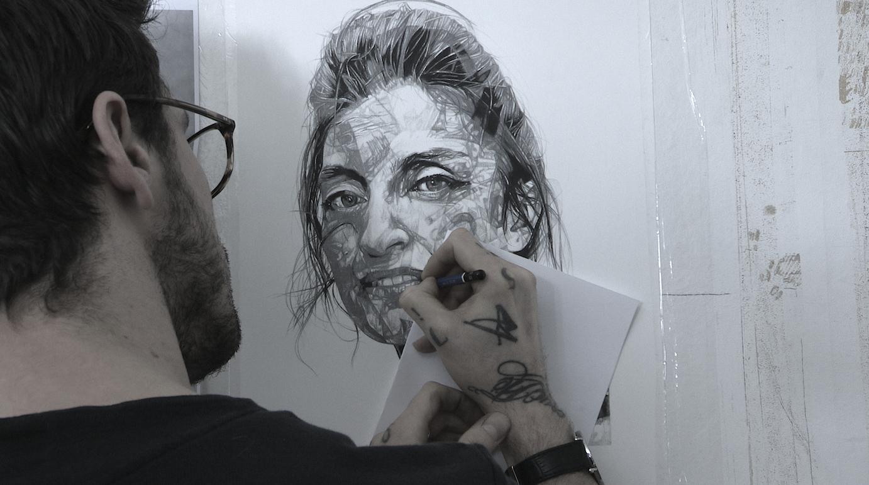 A photo of Nigel Stefani drawing