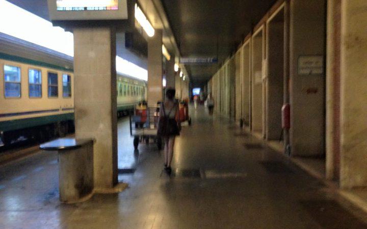girl walks through train station