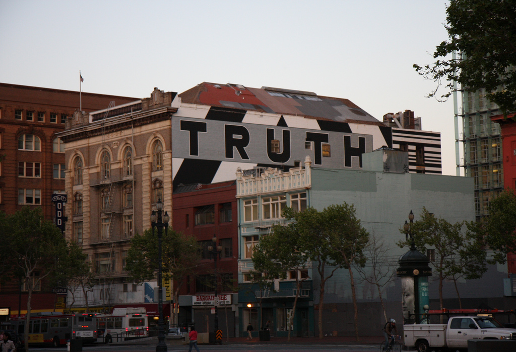 The word Truth painted on the side of a building