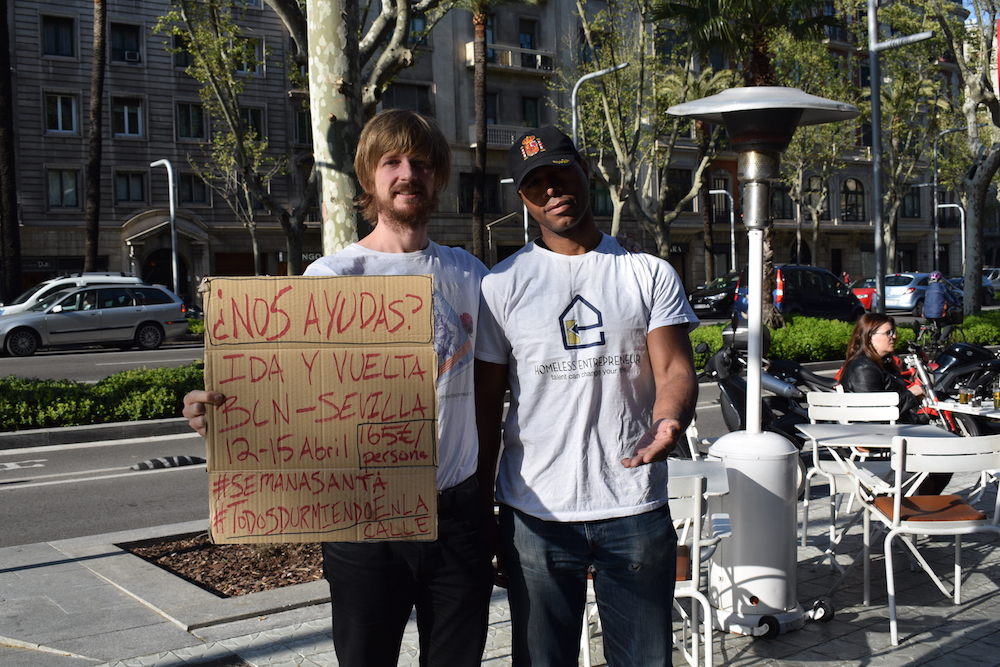 Two men holding a placard written in Spanish
