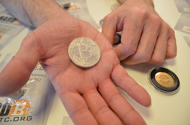 mock up of a bitcoin in someone's hand