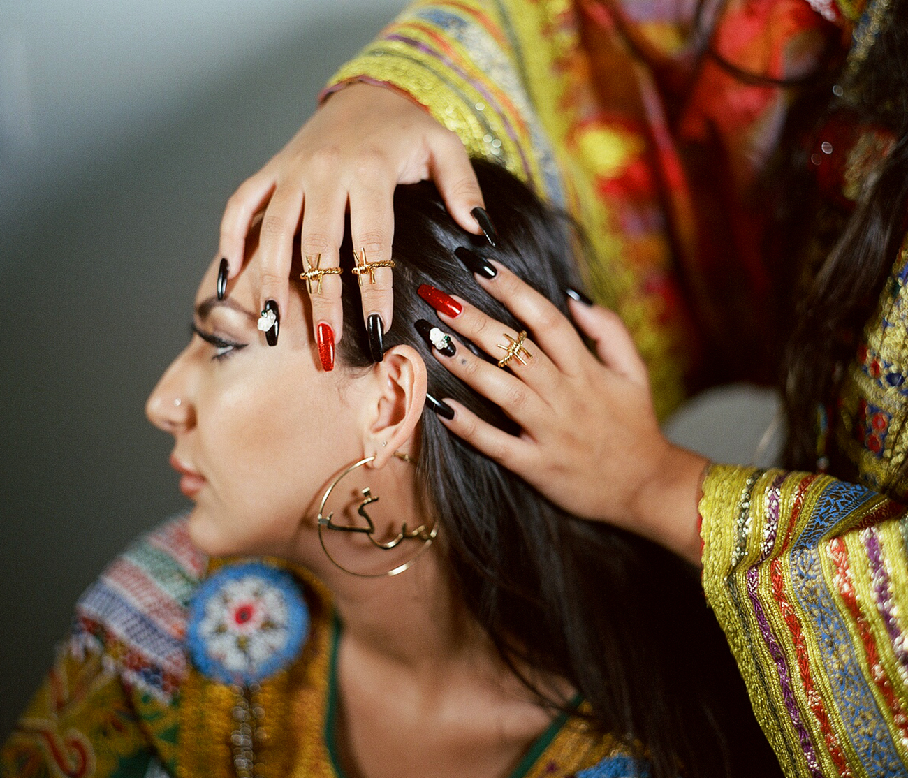 "Shamayel wearing Blingistan barb wire midi ring and ""Marg"" earrings/hoops (second collection)"