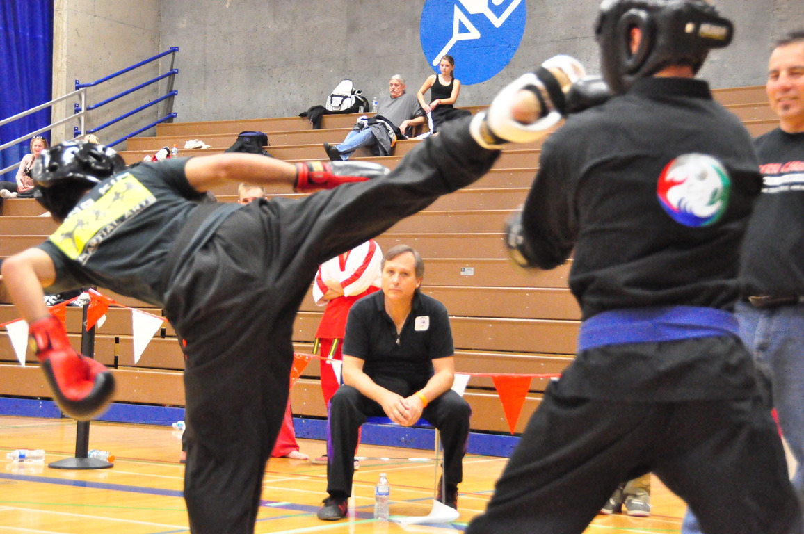 People practicing martial arts in a sports hall