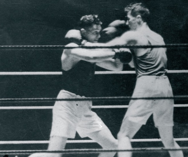 Jimmy in the ring with an unlucky opponent. Photo provided by Paul Magill