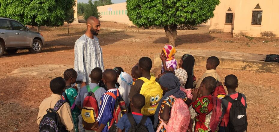 Kanoute with kids