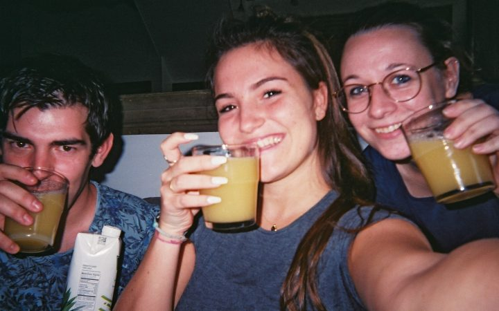 three of the couriers posing with pineapple juice