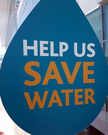 Poster that says Help us save water