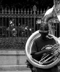 Black and white shot of a street musician