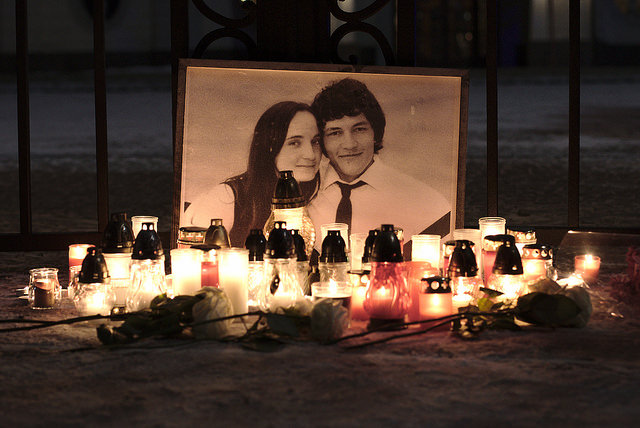 Picture with the murdered couple with candles lit up in front of it