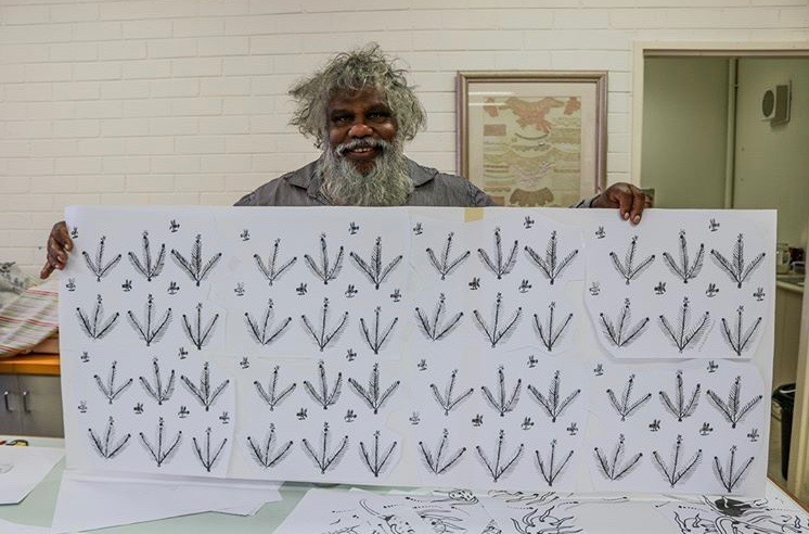 aboriginal artist with his print