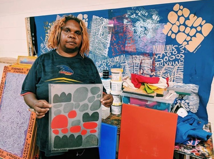 brightly coloured aboriginal art with artist