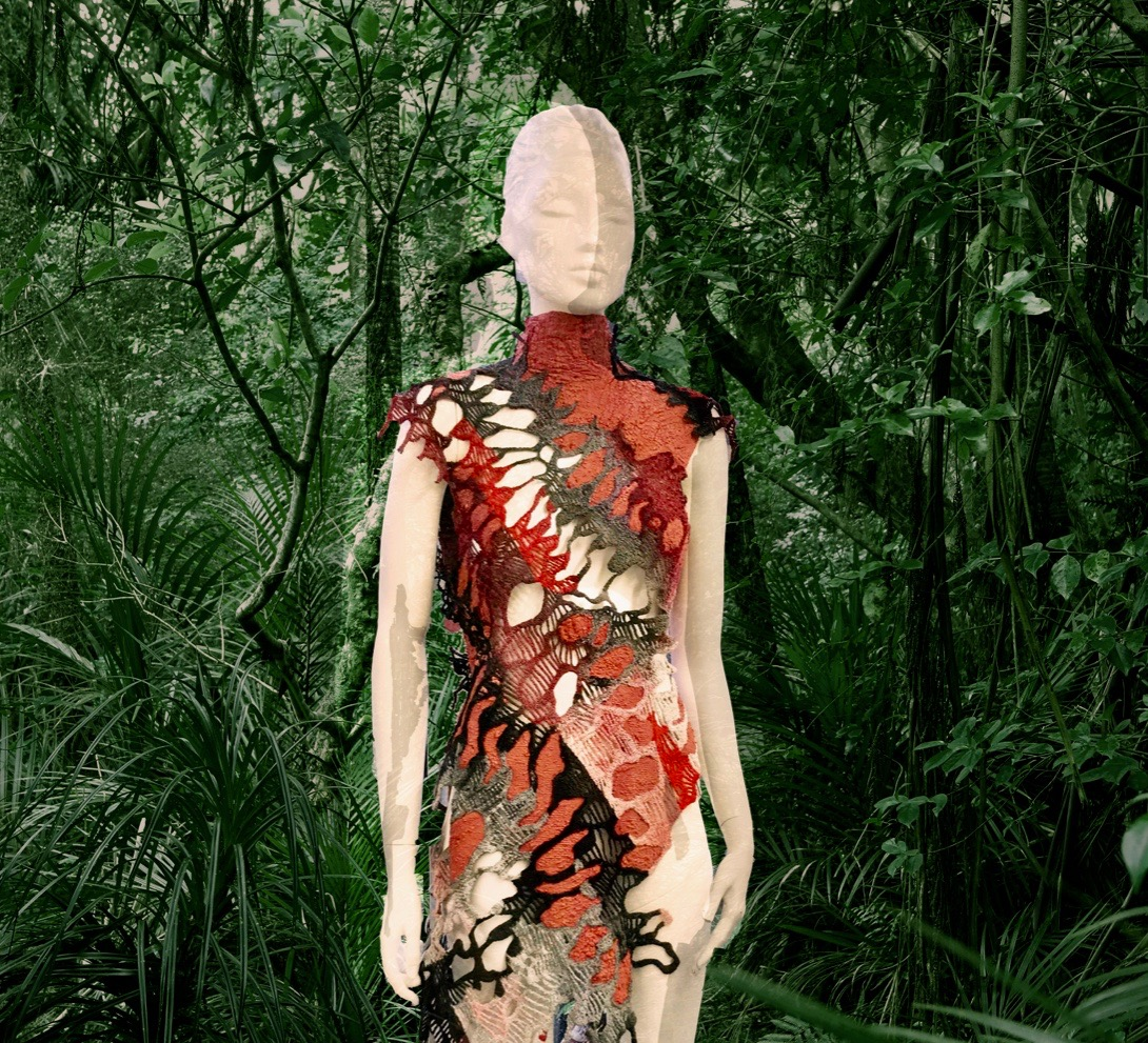 mannequin wearing an fabric representing lichens in front of green jungle background, photoshop edit