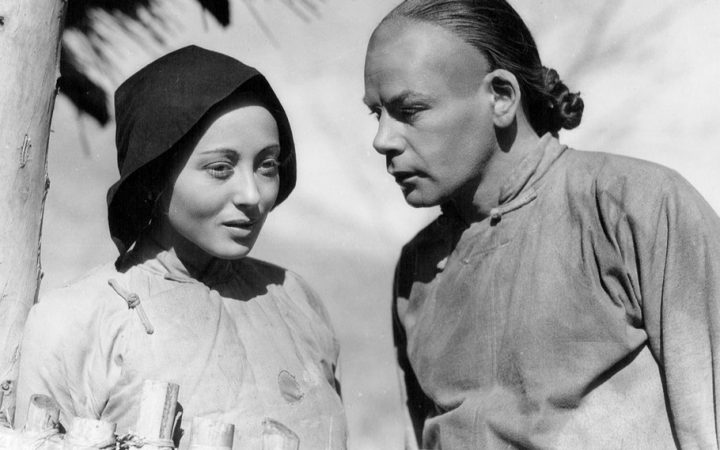Luise Rainer and Paul Muni on the set of the movie The Good Earth