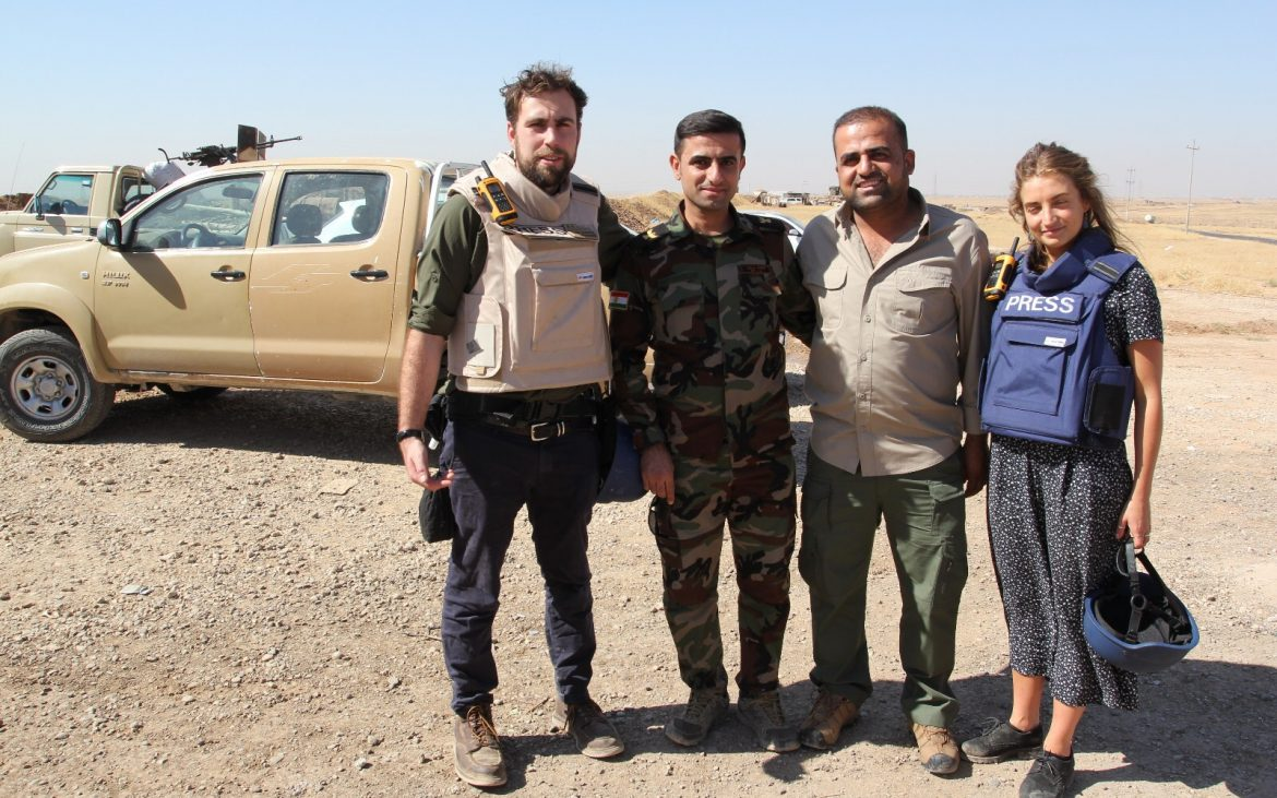 Josh Baker (director), Peshmerga solider, Karwan (fixer) and Helen stood nextto a van in mosul