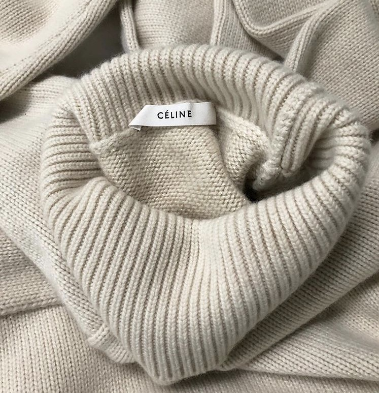 A beige knitted sweater designed by Phoebe Philo for Céline.