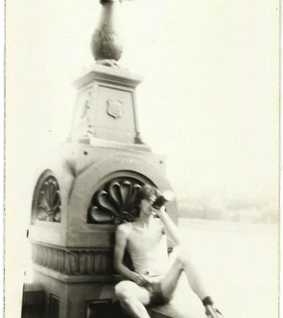 Miro drinking from a bottle on the Széchenyi Chain Bridge in Budapest