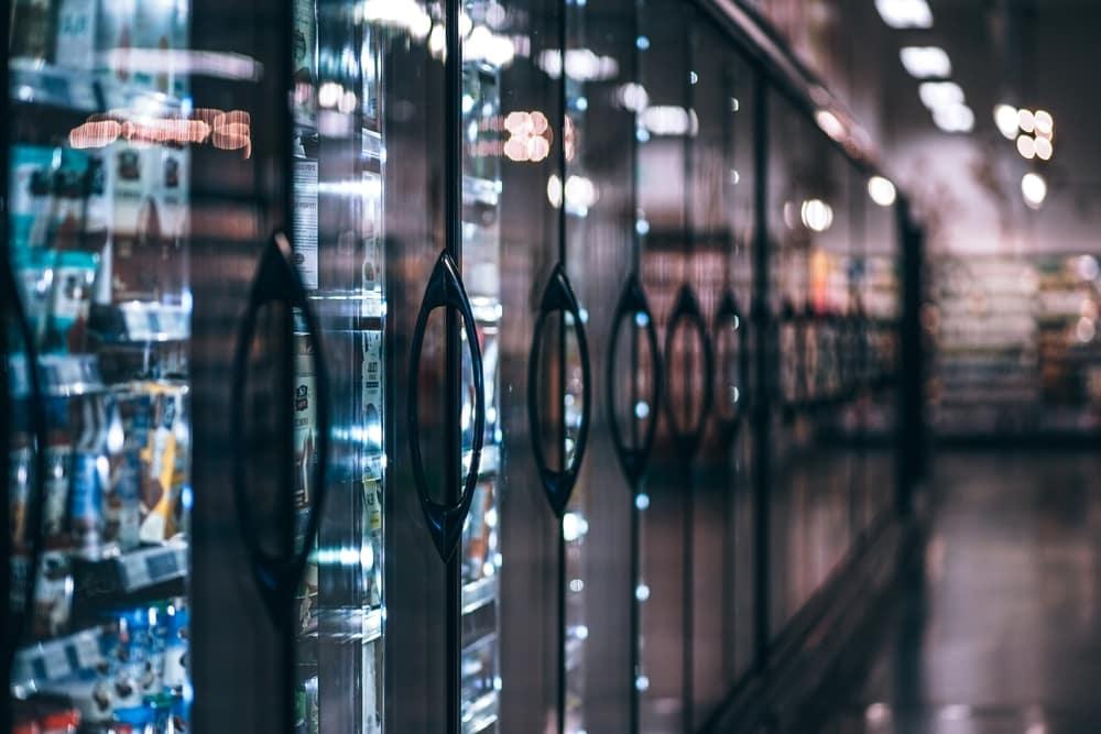 plastic behind refrigerator doors in supermarket