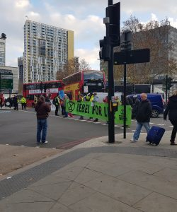 A group of protesters blocking a busy London road
