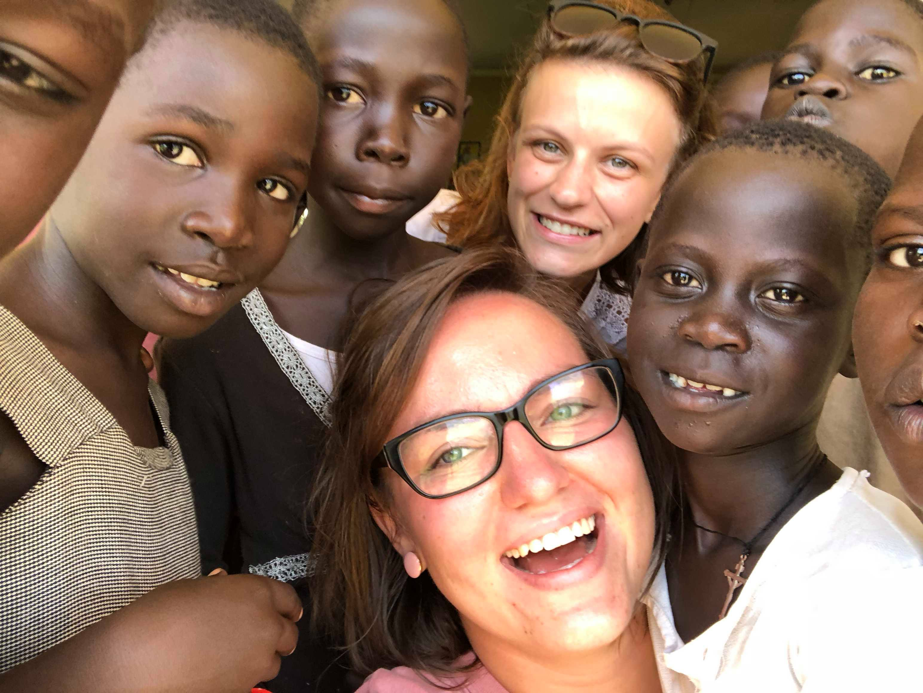Group of children with volunteers from the centre for HIV positive children in Uganda
