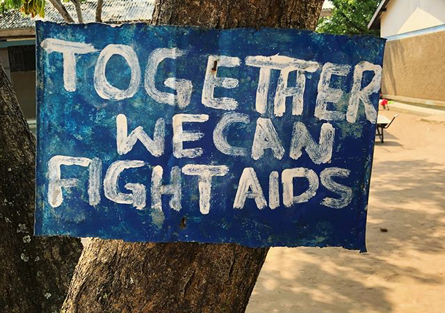 "Sign saying ""together we can fight aids"""