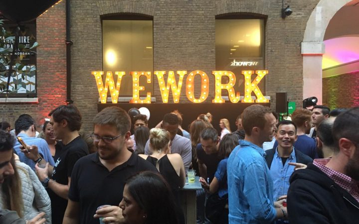WeWork celebrating their launch party outside their new HQ