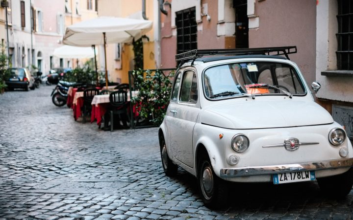 Photograph of car parked on streets of Rome