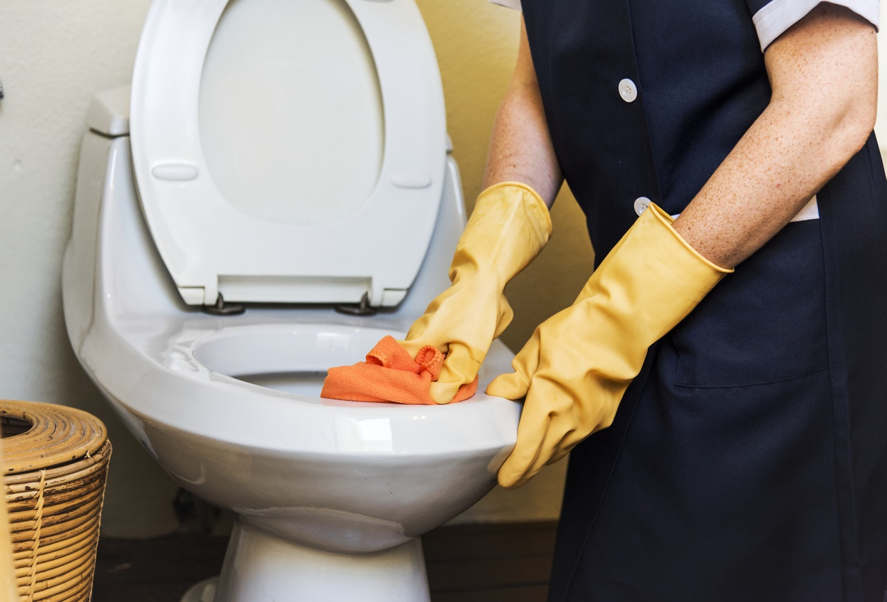 Image of person cleaning toilet [Rawpixel from Pexels.com]