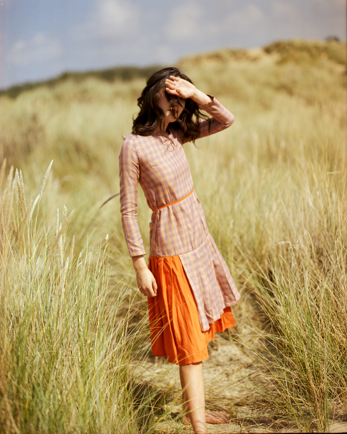 oshadi lookbook, girl in orange dress in field